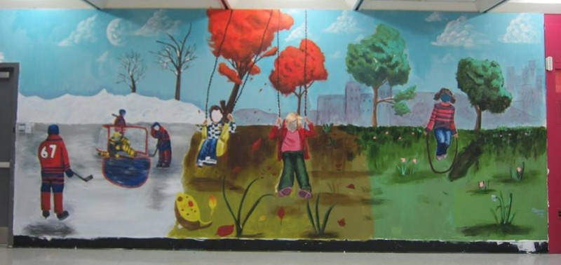 At St. Gabriel School, small teams of Grade 6 artists worked with three graduate artist facilitators to create murals within the school. This work portrayed fun things the students love to do outside, though the seasons.