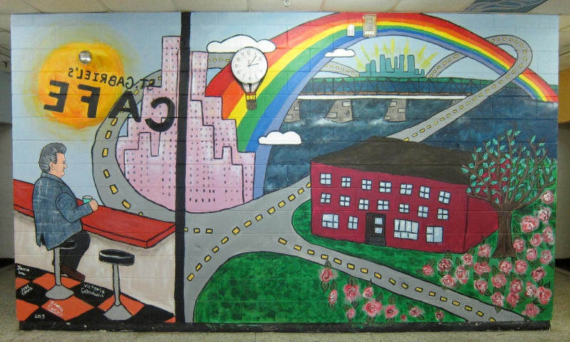 Imagining a future in which the city is their's to claim, the Grade 6 children designing this mural also wanted to include their beloved principal, Jim Daskalaskis, who is recognizably the figure sitting at the 'café', gazing out on the scene.